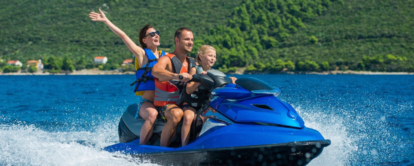 Farther, mother and daughter on a jet ski