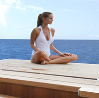 Woman doing yoga on yacht Lady Britt
