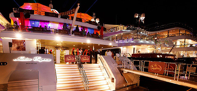 Stern of berthed luxury yacht at night