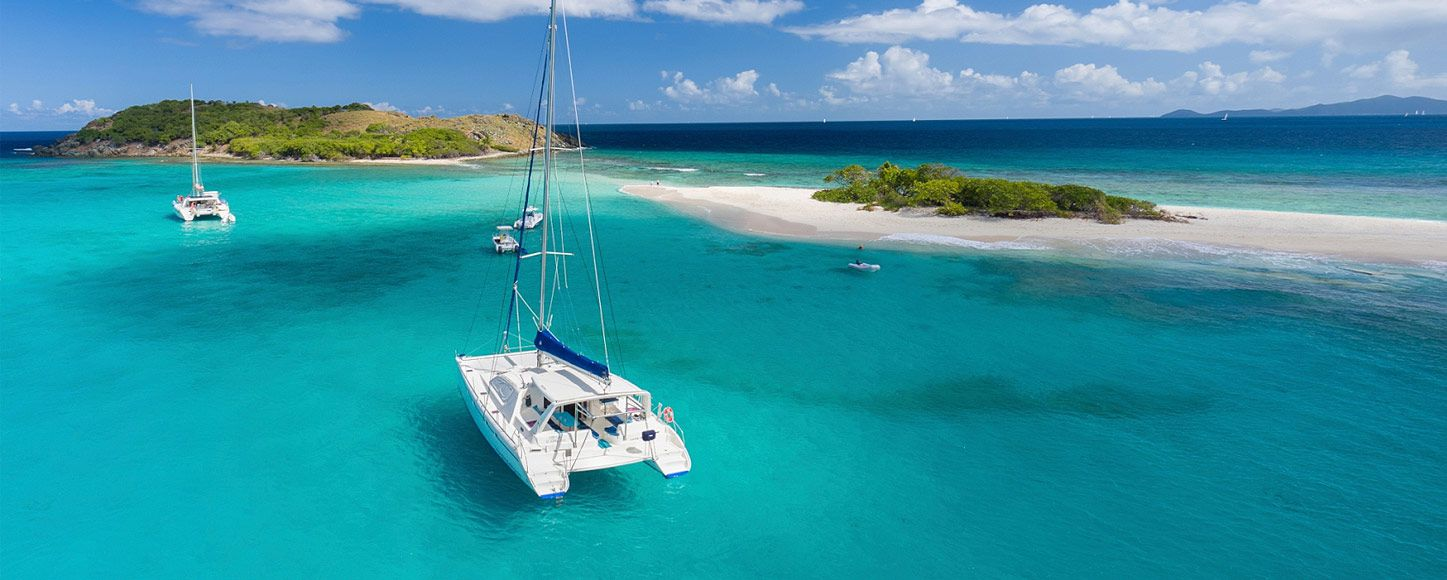 charter yachts anchored near islands in the Caribbean