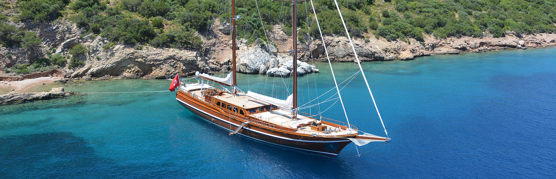 Gulet yacht Cakiryildiz anchored by the shore
