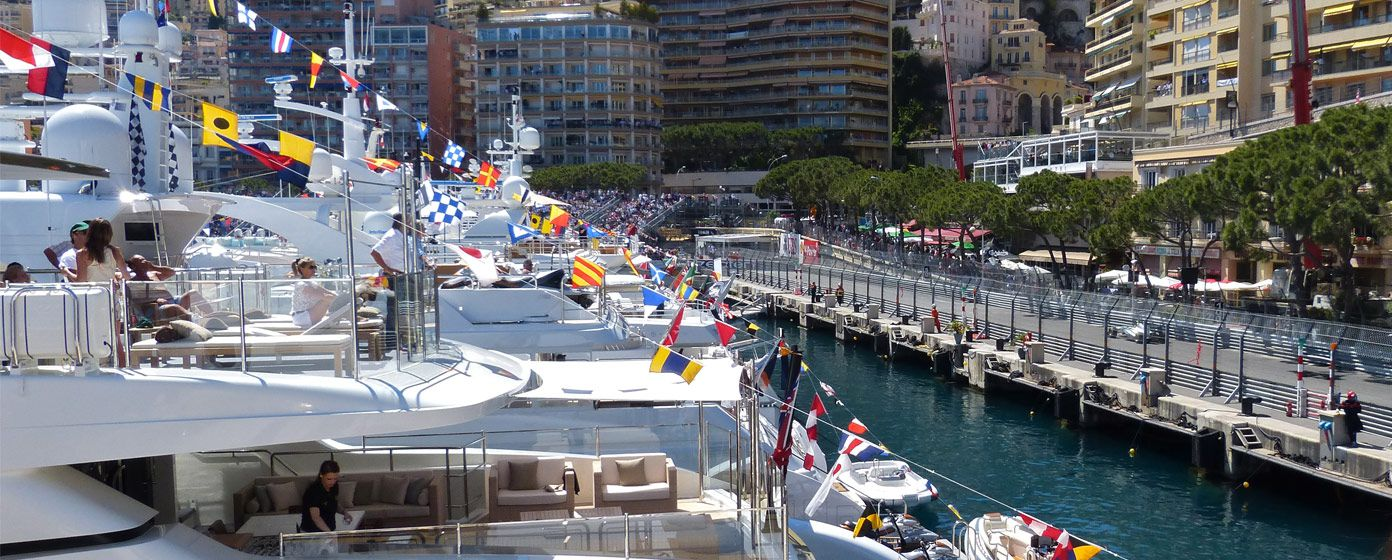 Superyacht passengers watching the Grand Prix