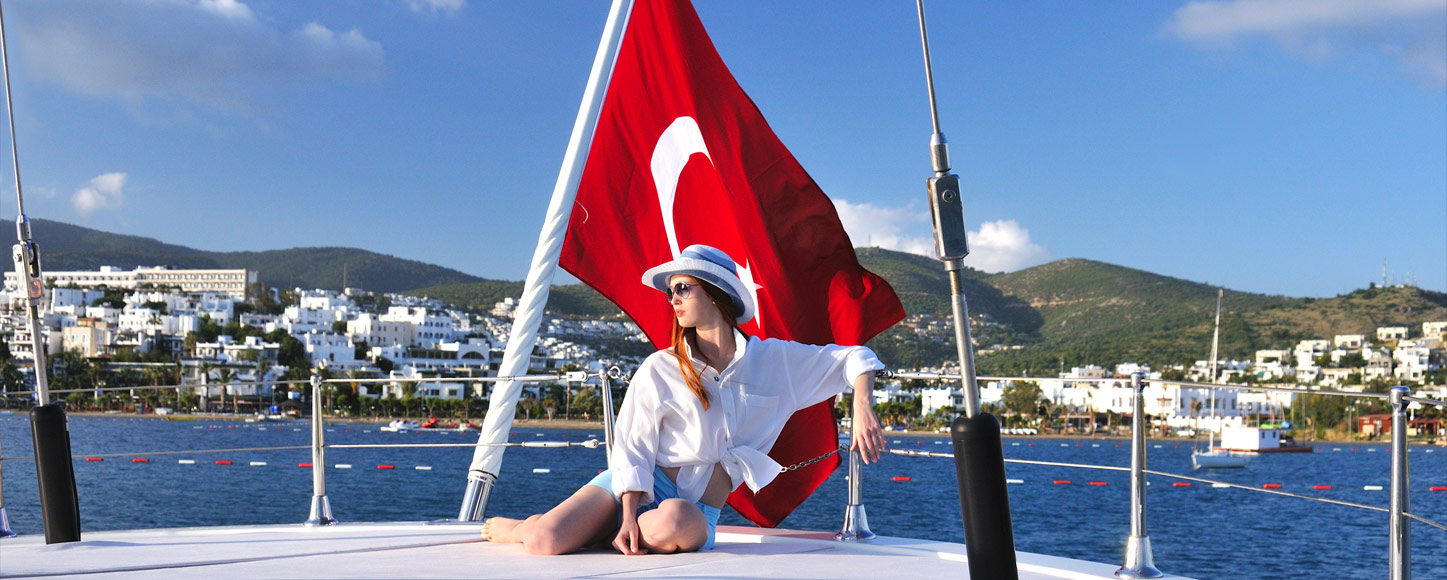 Luxury Gulet yacht Tuyika S with Turkish flag and women sitting