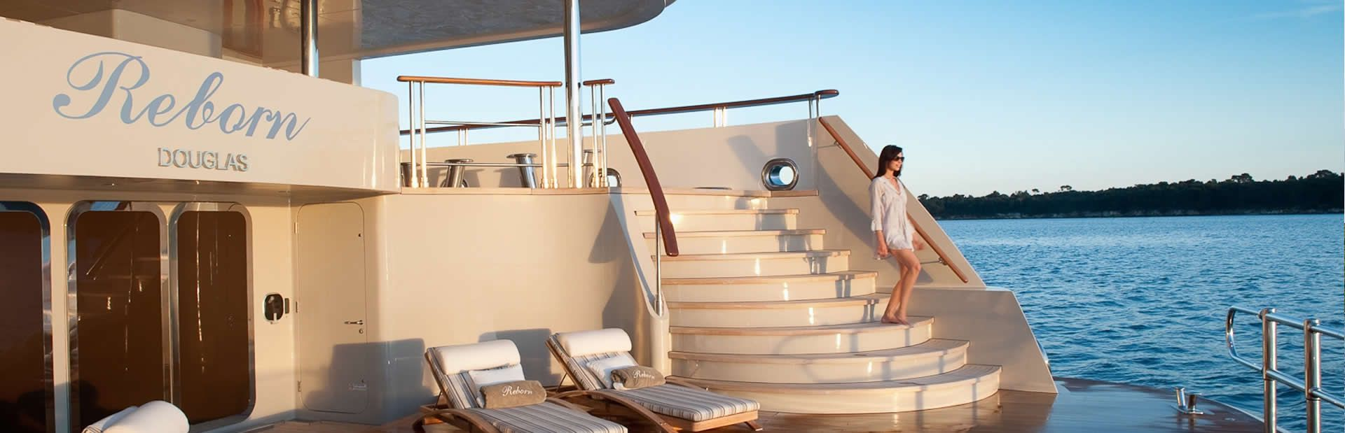 Charter yacht Reborn's Beach Club at sunset