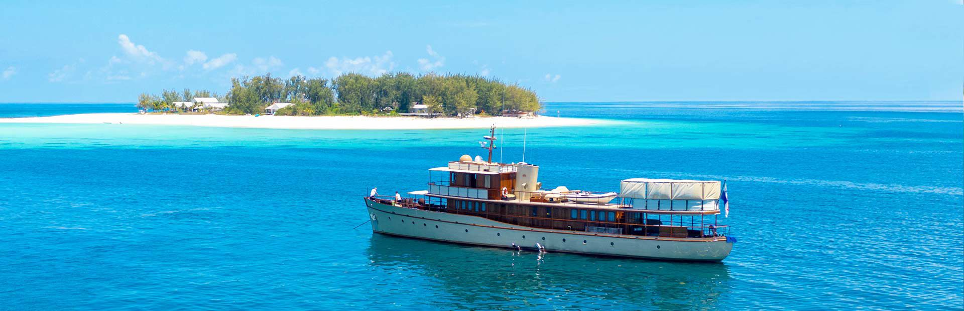 Motor Yacht Over The Rainbow at Anchor in front of Thanda Island